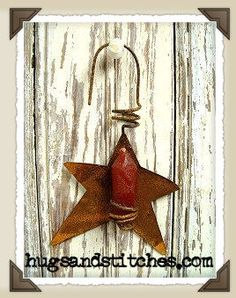9004 - Primitive Candle Star Ornament