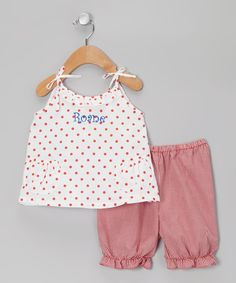 This oh-so-sweet duo makes us nostalgic for our own childhoods. Darling polka dots and custom embroidered details add to the heirloom quality that makes it feel it was created just for her. Sweet little pockets and tie straps add an extra dose of charm. Personalize up to eight charactersIncludes top and pants65% polyeste...