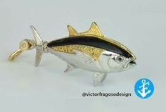 Black fin tuna. Majestic and elegant pendant that is sure to catch the attention of many. Hook line and sinker! Reel in this bad boy to your jewelry collection! 14k white & yellow gold + genuine black onyx & yellow/blue sapphires!