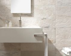 Neve Naturale - a beautiful porcelain tile, soft white, beige and grey shades blended perfectly. Coming soon to Welby & Wright.