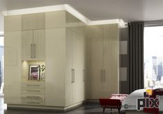 Contemporary recessed lighting surrounding the fitted wardrobes in this unique bedroom