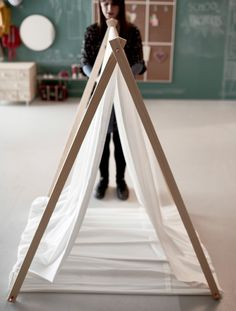 Open your indoor tipi frame inside the loop of fabric.