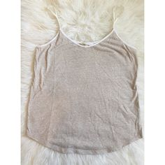 Vs basics Size = M, comfy cream tank , basic and can be worn up or down. From Victoria's Secret.  ~ I DO NOT SWAP, SO PLEASE DON'T ASK. YOU WILL BE IGNORED.  ~ I NO LONGER HOLD MY ITEMS, FIRST COME FIRST SERVE.   ~YOUR PURCHASE WILL BE SHIPPED WITHIN 24-48 HOURS AFTER PURCHASED, FROM THAT POINT ON I CANNOT CONTROL HOW LONG IT WILL TAKE FOR THE SHIPPING SERVICE TO GET IT TO YOU. *PLEASE BE PATIENT*  ~I AM MORE THAN HAPPY TO MAKE YOU A BUNDLE. Victoria's Secret Tops Tank Tops