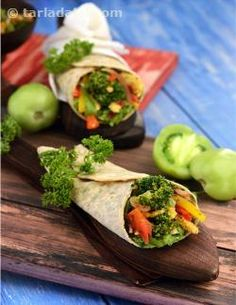Exciting iron-rich serving coming up! A perfect low-calorie main course dish, the Green Tomato Salsa and Veggie Wrap is packed with crunchy veggies for not just good health but an enjoyable texture and taste too. Iron-rich soya flour and parsley used in the dough pack more iron into this sumptuous wrap.