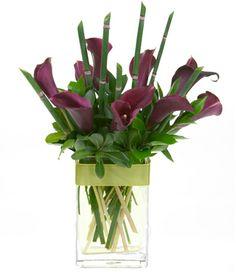 Twenty four gorgeous Long Stem Roses in a clear vase