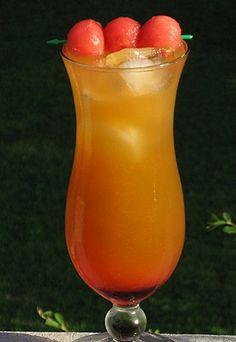 Watermelon Slice  (.75 oz. Rum   .75 oz. Gin  .75 oz. Vodka    .5 oz. Triple Sec  1 oz. Watermelon Pucker  1 oz. Strawberry Pucker  1.5 oz. Orange Juice  1.5 oz. Cranberry Juice  .5 Grenadine  Watermelon balls for garnish)