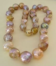 Golden, pink, purple South Sea pearls.