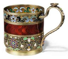 A SMALL RUSSIAN SILVER-GILT AND CLOISONNE, PLIQUE-A-JOUR AND TRANSLUCENT ENAMEL TEA-GLASS HOLDER