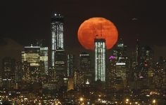 40 Incredible Pictures Of One World Trade Center Under Construction. This is a full moon over the new Manhattan skyline that includes One World Trade Center as seen from West Orange, New Jersey. Lower Manhattan, Manhattan Skyline, Nyc Skyline, Manhattan Nyc, One World Trade Center, Trade Centre, Nebraska, Oklahoma, Wyoming