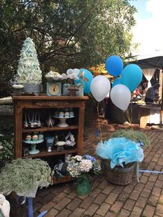 Vintage cabinents , baskets of babies breath , balloons and desserts