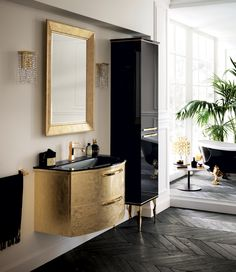 Great beauty and #luxury characterise this bath furnishing solution with #gold leaf finish. Bright glossy materials for Magnifica #bathroom.