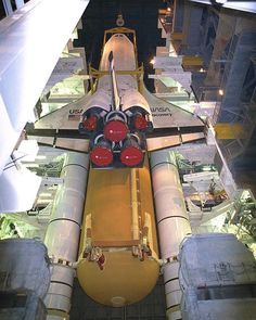 Some great photos showing the mating of the orbiter with the external fuel tank and boosters. Easy does it, precious cargo just hanging around.