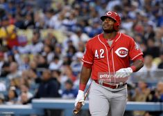 c165e30ef9c Yasiel Puig  24 of the Cincinnati Reds reacts during his first at bat in his