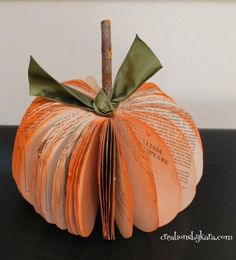 DIY book page pumpkin tutorial for your Halloween party and Fall decorations