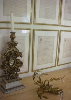 Love this idea for a gallery wall, old French letters framed in small gold frames.