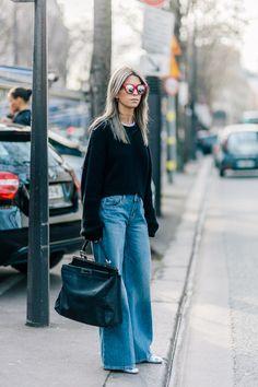 Carola Bernard wearing Zara jeans, Fendi bag, Spektre sunglasses and Saint Laurent boots after the Isabel Marant Fall/Winter 2015-2016 fashion show in Paris, France