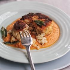 Risotto Cakes with Smoked Tomato Sauce.  You can make them as small as you like and serve as an hors d'oeuvres.  Also a great use for leftover risotto.