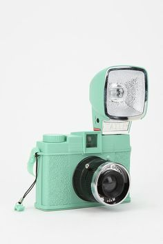 A Diana Fx Camera with attached Flash case. Mint color :0) .....very 2013!