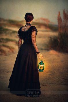 © Susan Fox / Trevillion Images -  Victorian woman beach night lantern