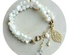 White and elegance anytime together. Gold and pearls boho bracelet with charms, semply delicious, discover more on etsy.