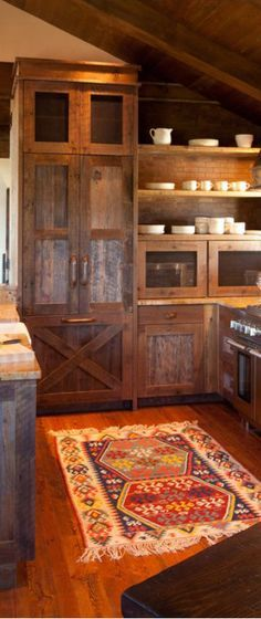30 Rustic Kitchens Designed by Top Interior Designers - - View rustic kitchens designed by the best rustic interior designers. From farmhouse kitchens to log homes and cabins with rustic kitchen ideas & tips. Dark Wood Kitchen Cabinets, Dark Wood Kitchens, Cabin Kitchens, Rustic Cabinets, Cool Kitchens, Rustic Kitchens, Open Cabinets, Cupboards, Unfinished Cabinets