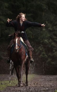 Katie Stearns and her horse, Magic, practice horseback archery on her ranch near Arlington. Stearns has traveled the world, including to Mon...