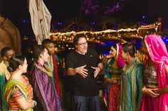 "Filmmaker Jon Favreau congratulates cast members of ""The Jungle Book: Alive with Magic"" musical Friday, May 27, 2016, during opening weekend of the new nighttime show at Disney's Animal Kingdom in Lake Buena Vista, Fla. Favreau collaborated with Walt Disney World Resort on the epic, limited-engagement celebration, featuring live performers, music, water screens and vibrant costumes, inspired by Indian culture and the blockbuster live-action film, ""The Jungle Book."" (Chloe Rice, photographer)"