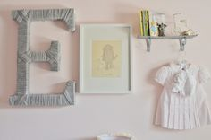 Our favorite kind of nursery gallery wall: sentimental + fun art + texture. Adorable! #gallerywall #nursery