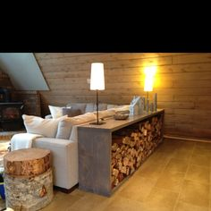 Indoor wood storage double as a console table. Would be fab in the new family room!
