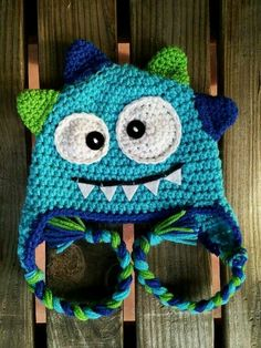 Crochet baby monster hat blue I usually dont like doing faces/eyes because I cant get them the same. Maybe this would work? Crochet baby monster hat blue I… Crochet Kids Hats, Crochet For Boys, Crochet Beanie, Crochet Crafts, Yarn Crafts, Crochet Projects, Knit Crochet, Earflap Beanie, Crocheted Hats