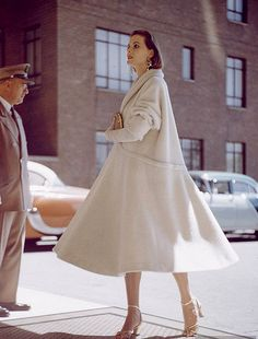 White wool swing coat with push-up sleeves, photo by Nina Leen 1954.