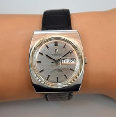 Much like Mr. Agnelli, we too have taken a liking to the funkier side of vintage Omega! A 1969 vintage Stainless steel Omega Day-Date Constellation Ref. 168.041 with a 40mm wide, television-shaped case, patinated silver dial and applied rectangular, bar markers. (Store Inventory # 9939, listed at $1700).  #agnelli #funky #70s #constellation #omega #tonneau #barrel #shape #watch #vintage #watches #classic #wristwatches #stawc
