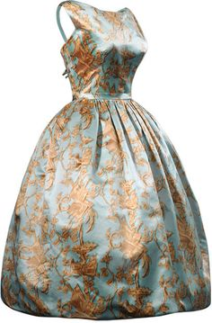 Balenciaga c1957 | Cocktail dress in blue satin, decorated with a golden candelieri print.