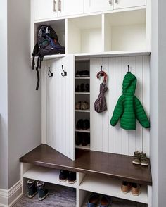 Our creative mudroom design features hidden shoe storage cabinets behind panelle. - Our creative mudroom design features hidden shoe storage cabinets behind panelled doors dressed wit - Coat And Shoe Storage, Entryway Shoe Storage, Entryway Closet, Diy Shoe Storage, Storage Hacks, Shoe Cubby, Hidden Storage, Closet Doors, Closet Mudroom