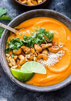 Thai Sweet Potato Carrot Soup: creamy, sweet, a little spicy and full of flavor - a healthy and filling soup that is sure to warm you up on a cold day.