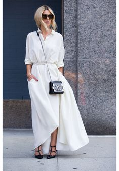 Maxi length white shirt dress with thin white belt and black accessories
