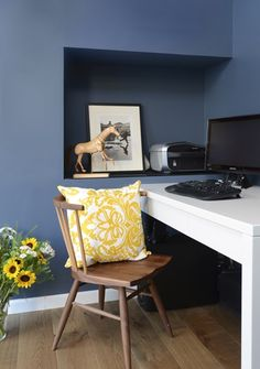 A blue office with a wooden chair and a yellow pillow, next to a white desk. Designed by Liat Hadas, Architecture & Design. . #Design #Architecture #Table #lifestyle #Colors #Mediterranean #View  #Styling #textile #Library #Wood  #furniture  #Walldecor #Wallcolor  #storage #storagedesign #Covertstorage #storage  #Officedesign #OFFICESTORAGE