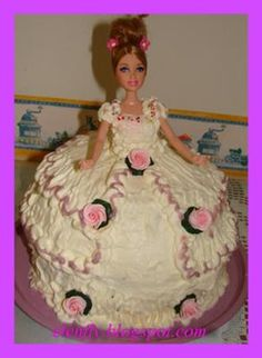 In the 1950s, Mom made gorgeous doll cakes for my sister and me. It made a little girl feel very special. This pre-dated Barbie by quite a bit and the doll did not look as sophisticated as this. But the rosettes and ribbons and icing were as pretty as can be.