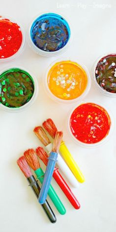 Homemade paint recipe for confetti paint. These paints are gorgeous and glossy and only require three simple and inexpensive ingredients.