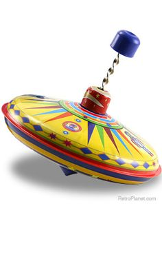 SPINNING TIN TOY TOP ... I remember playing with this for hours at my great grandmother's house.