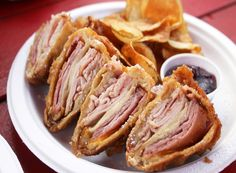 The Shiner Bock Beer-Battered Monte Cristo from Hey!...You Gonna Eat or What?, a food truck in Austin, TX. It's made with pit-smoked ham, mesquite-smoked turkey, cheddar cheese, provolone cheese, homemade cherry-fig jelly, AND it's served with housemade potato chips. NICE!