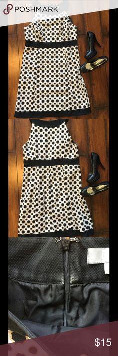 Black and white dress Classy black and white dress. Would look great with black heels. Euc. Only wear is on the inside by the tag shown in pic 3. Merona Dresses