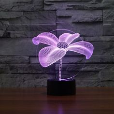 Product Overview The Flower 3D LED Illusion Lamp is a combination of art and technology that creates an optical 3D illusion and plays tricks on the eyes. From afar, you will see the design, but as you