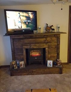 Already have ideas for weekend project? How about replacing your old TV stand with a new one? Find your DIY TV stand ideas here. Pallet Fireplace, Simple Fireplace, Fake Fireplace, Fireplace Tv Stand, Rustic Fireplaces, Farmhouse Fireplace, Fireplace Drawing, Fireplace Hearth, Electric Fireplace