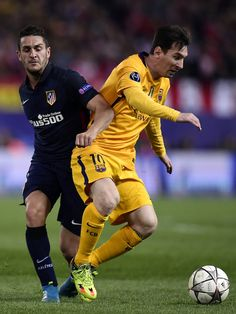 Barcelona's Argentinian forward Lionel Messi (R) vies with Atletico Madrid's midfielder Koke during the Champions League quarter-final second leg football match Club Atletico de Madrid VS FC Barcelona at the Vicente Calderon stadium in Madrid on April 13, 2016.