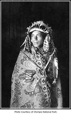 Native American man wearing a headdress and blanket, possibly on the Olympic Peninsula, date unknown. - Photo courtesy of Olympic National Park.