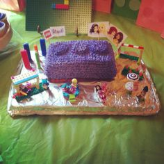 Lego friends birthday cake. I used a loaf pan and and three Reese cups (freeze before decorating) on top. I used a Wilton star tip for decorating. I added my daughters lego sets around the cake and found lego candles to go on top.