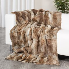 1f3bbef4fd The natural brown rabbit fur blanket is made with genuine rabbit fur pelts.  It s a