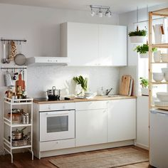 small white kitchen. you don't need what they make you think you need.