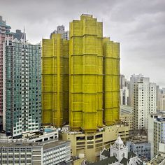 singapore-based photographer peter steinhauer documents the architecture within the urban landscape of hong kong from an uncommon perspective -- when the monolithic structures are under construction like a cocoon. Colourful Buildings, Built Environment, Elements Of Art, Brutalist, Color Stories, Installation Art, Interior Architecture, Hong Kong, Facade
